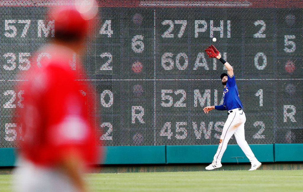 Texas Rangers left fielder Joey Gallo (13) catches a fly ball from Los Angeles Angels catcher Jonathan Lucroy (20) during the second inning of play at Globe Life Park in Arlington, Texas on Tuesday, July 2, 2019. (Vernon Bryant/The Dallas Morning News)