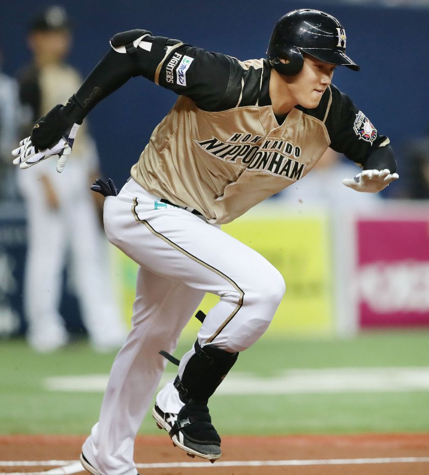 In this Saturday, April 8, 2017 photo, Japanese baseball player Shohei Otani of the Nippon Ham Fighters dashes to first base after hitting a grounder in the first inning of a game against the Orix BlueWave in Osaka, western Japan. (Yohei Fukuyama/Kyodo News via AP)