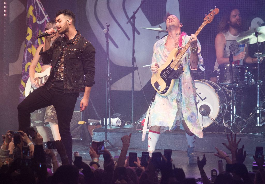 JinJoo Lee, left rear,  Joe Jonas, left, Cole Whittle, right, and Jack Lawless, right rear, of the band DNCE, perform at the Granada Theater on Saturday, Jan. 28, 2017.   (Rex C. Curry/Special Contributor)