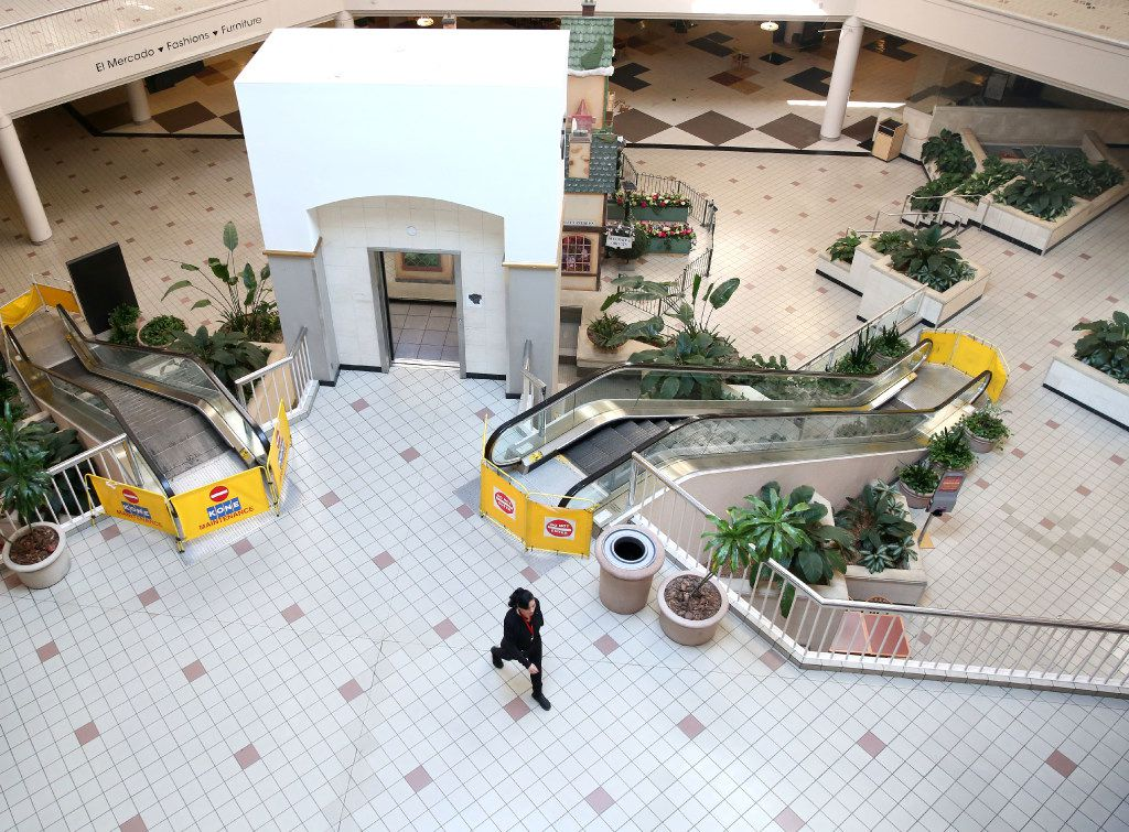 A woman walks across the interior of Valley View Mall in Dallas on Wednesday, Feb. 1, 2017.