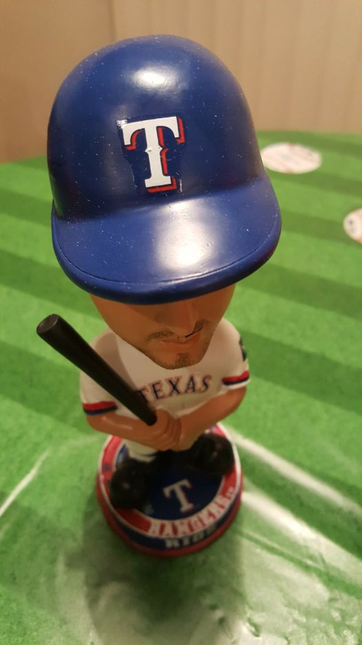 An Alex Rios bobblehead from the collection of Johnnie Lehew. The Fort Worth resident has been collecting the figurines since 2001. (Tommy Noel/Staff Photographer)