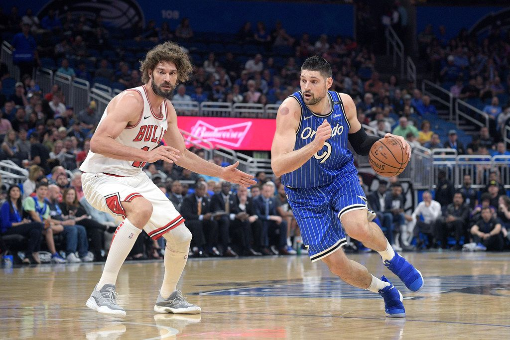 Orlando Magic center Nikola Vucevic (9) drives to the basket in front of Chicago Bulls center Robin Lopez (42) during the first half of an NBA basketball game Friday, Feb. 22, 2019, in Orlando, Fla. (AP Photo/Phelan M. Ebenhack)