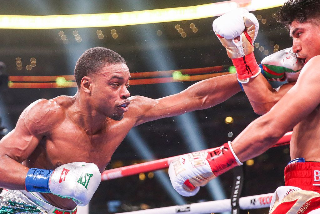 Errol Spence Jr. lands a punch on Mikey Garcia during a IBF World Welterweight Championship match on March 16, 2019 at AT&T Stadium in Arlington, Texas. (Ryan Michalesko/The Dallas Morning News)