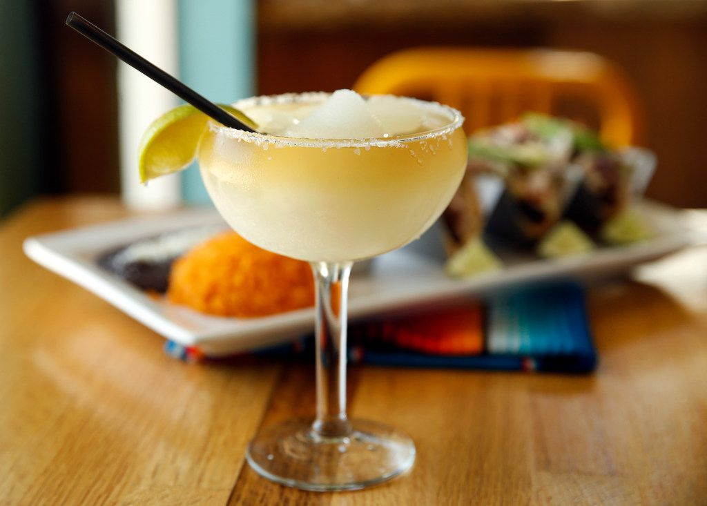 The frozen house margarita is served with fish tacos at El Rincon Mexican Restaurant & Tequila Bar in downtown Carrollton, Texas, Thursday, April 25, 2019. (Tom Fox/The Dallas Morning News)