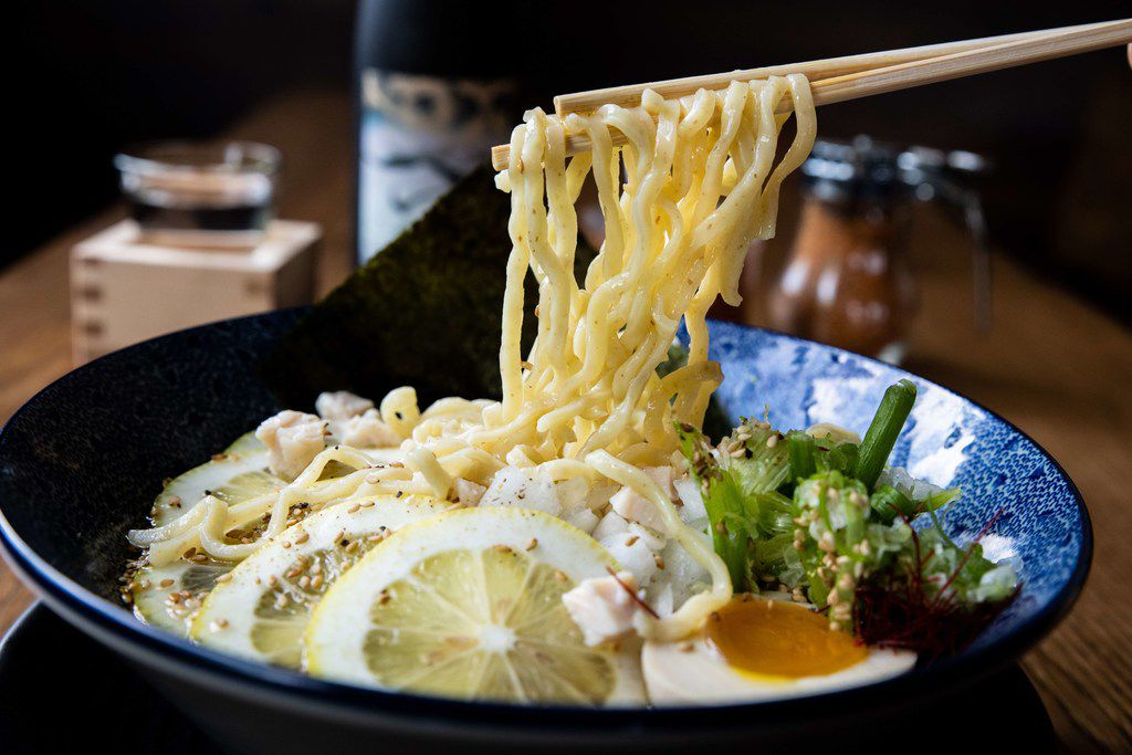 Hinodeya's special cold summer ramen bowl is served only in Dallas and includes chicken, scallions, lemon and marinated soft-cooked egg.