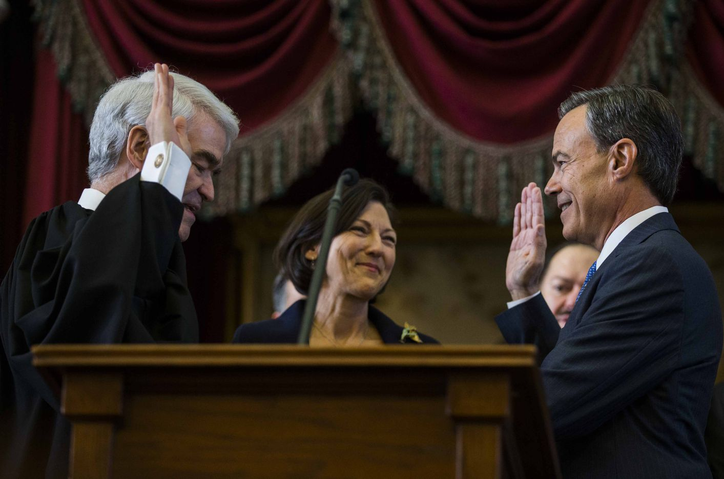State Rep. Joe Straus is sworn in as Speaker of the House by Texas Chief Justice Nathan Hecht during the first day of the 85th Texas Legislative Session on Tuesday at the State Capitol in Austin. Straus' wife, Julie Brink, is at center.