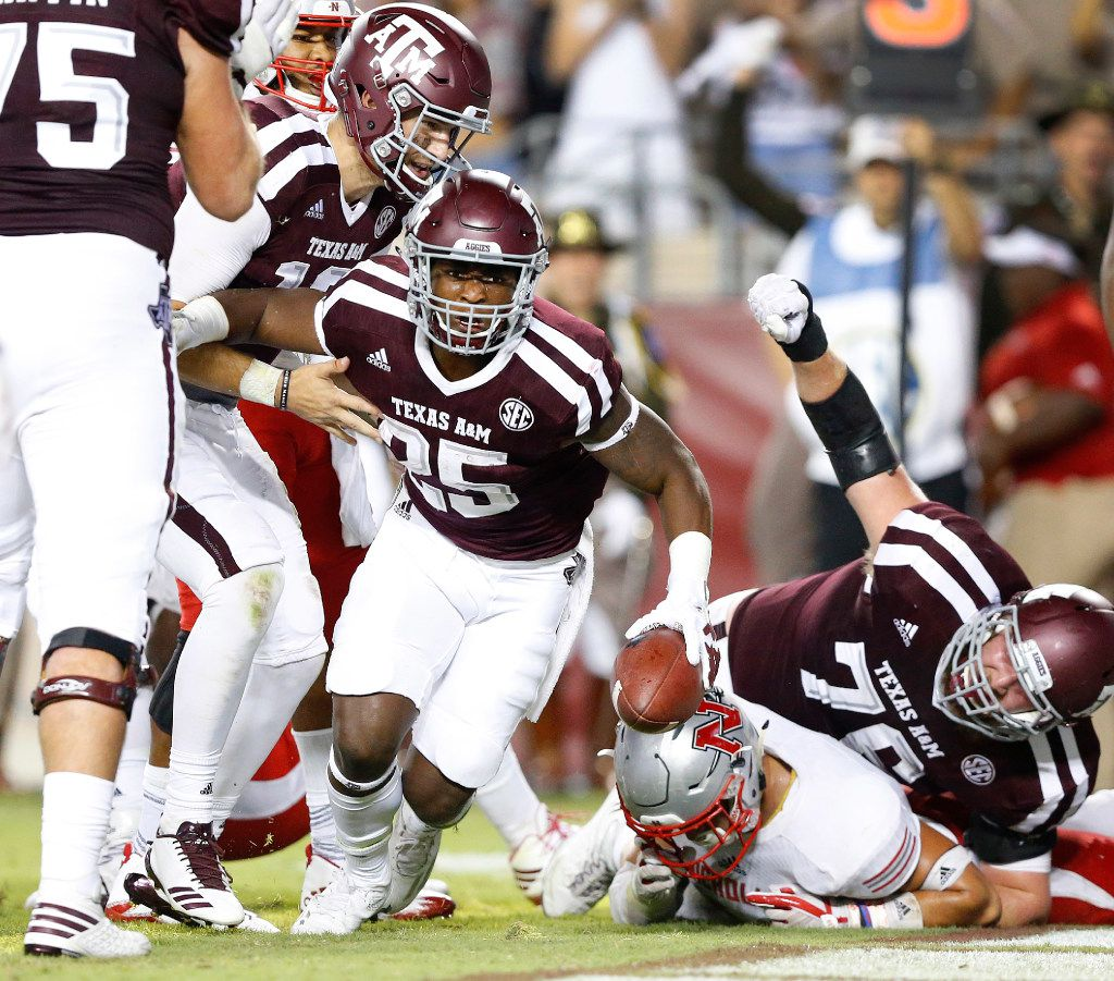 Texas A&M Aggies running back Kendall Bussey (25) comes up with a fourth quarter touchdown to break the tie as his teammates celebrate against the Nicholls State Colonels at Kyle Field in College Station, Texas, Saturday, September 9, 2017. The Aggies defeated the Colonels, 24-14. (Tom Fox/The Dallas Morning News)
