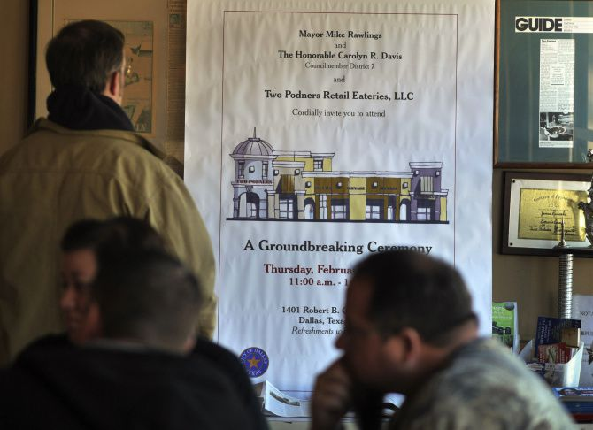 A notice of the ceremonial groundbreaking that takes place today hangs inside Two Podners Bar-B-Que and Seafood.