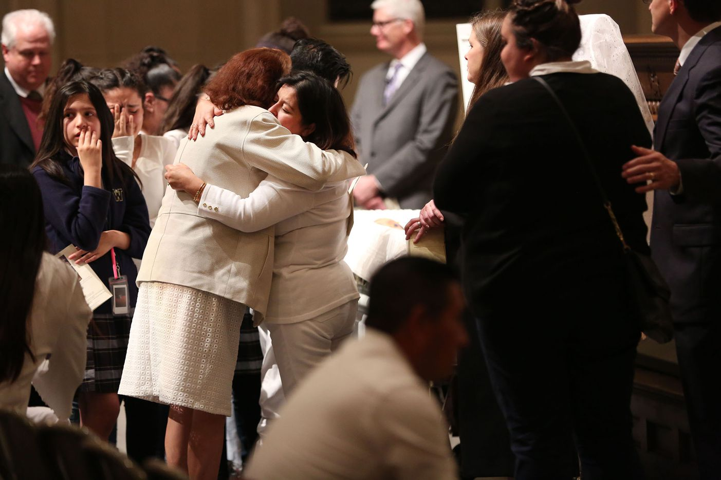 A woman hugs Maria Rogers (right), mother of deceased 12-year-old Linda Rogers, during a memorial service and viewing at Park Cities Presbyterian Church in Dallas on Thursday, March 1, 2018.