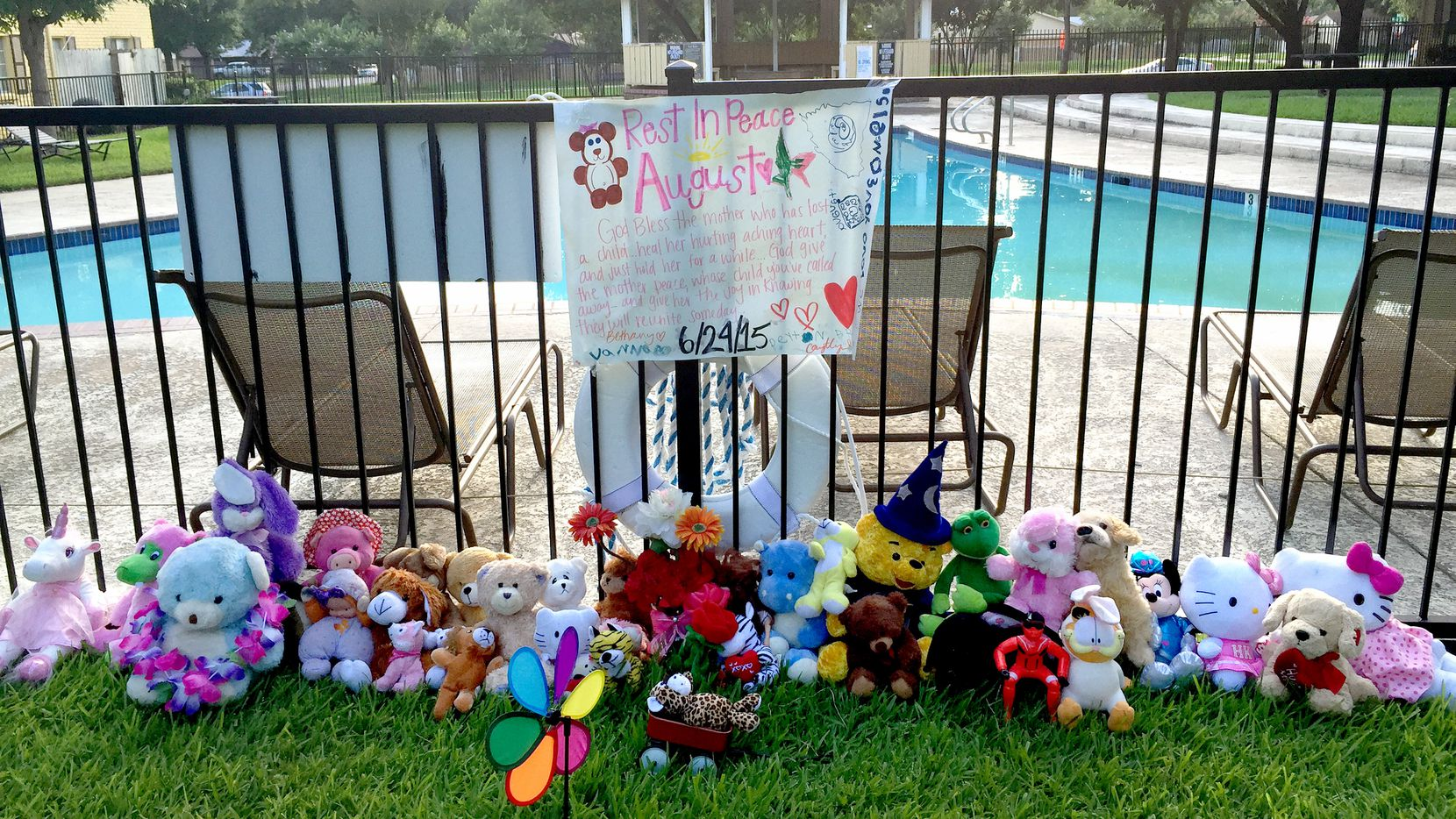 A memorial was set up outside the pool at the MacArthur Place at 183 complex in Irving where August Smith, 10, and her brothers, Treshawn Smith, 9, and Anthony Smith, 11, drowned.