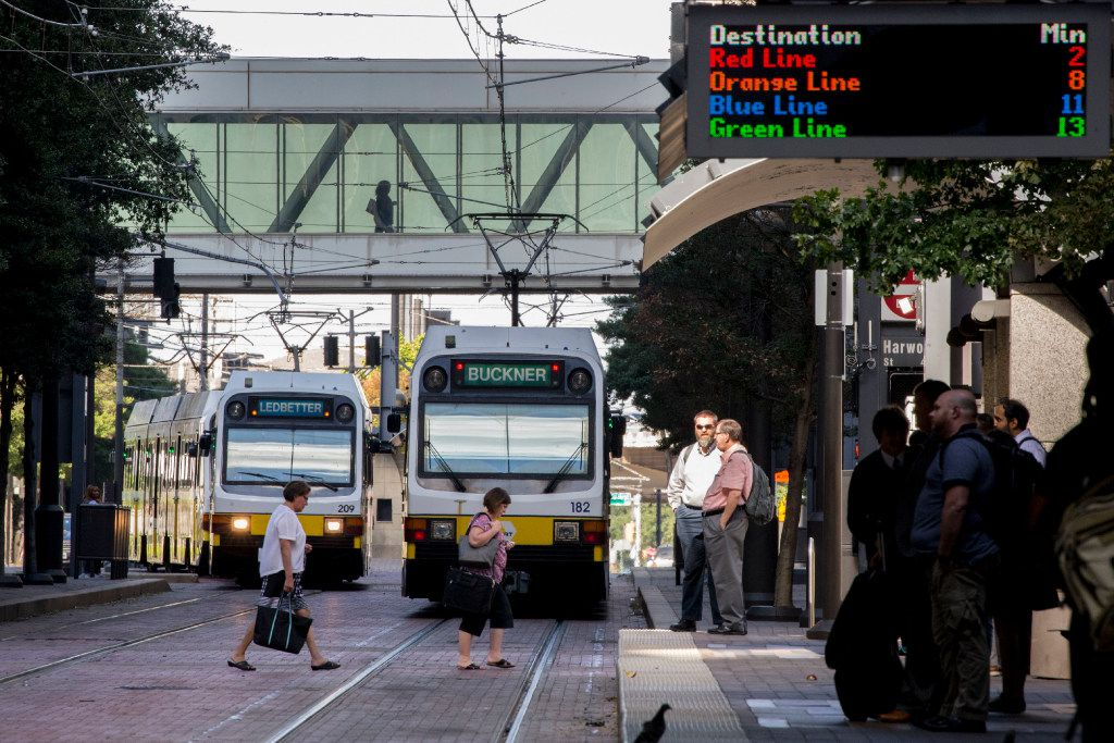Blue line and Green line trains on the rails as people wait for DART light rail trains at St. Paul Street DART station on Sept. 12, 2016 in Dallas.