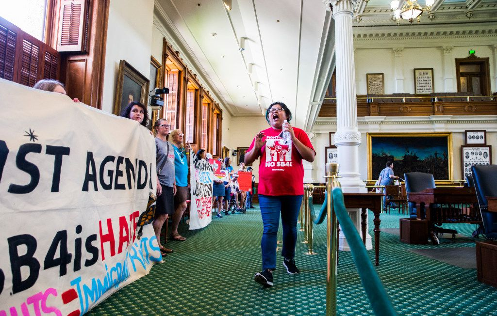 Yunuen Alvarado of Austin leads protesters as they chant on the Senate floor as they wait in line to sign the guestbook of Lt. Gov. Dan Patrick during a One Texas Resistance rally on the first day of a legislative special session on Tuesday, July 18, 2017 at the Texas state Capitol in Austin. Demonstrators were told they could not protest outside Patrick's office, so they each signed his guestbook in the hallway.