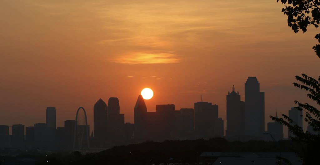 The sun rises over the Dallas skyline in a file photo. Hospitals are gearing up as temperatures are expected to spike in the coming days.