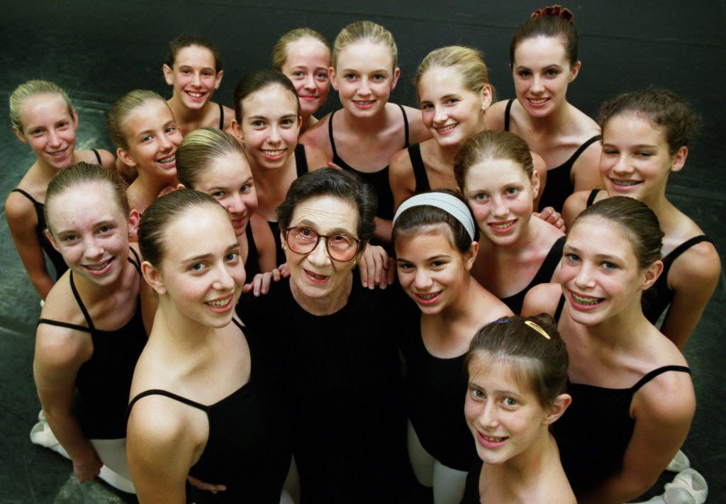 Photograph taken in 2000 of Denise Brown (center) with a class of girls she has instructed for the past five years at City Ballet. Ms. Brown participated in the French Resistance during World War II.