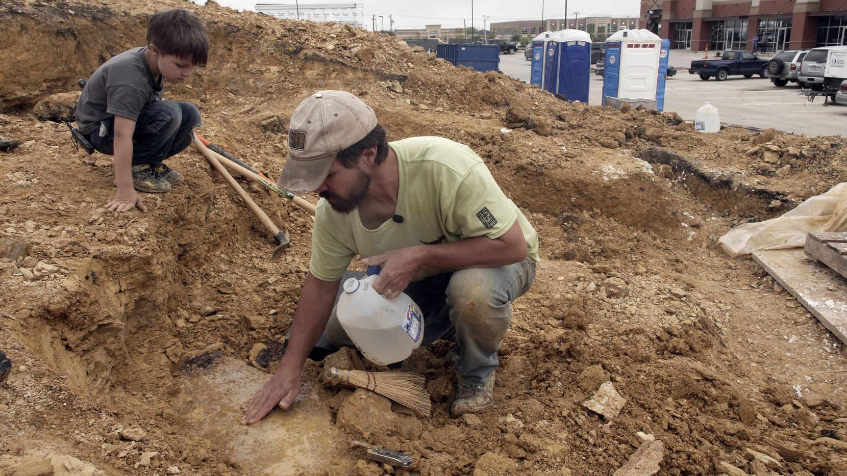 Five-year-old Wylie Brys and his father, Dallas zookeeper Tim Brys, were still looking for fossils Tuesday at the dig site in Mansfield.
