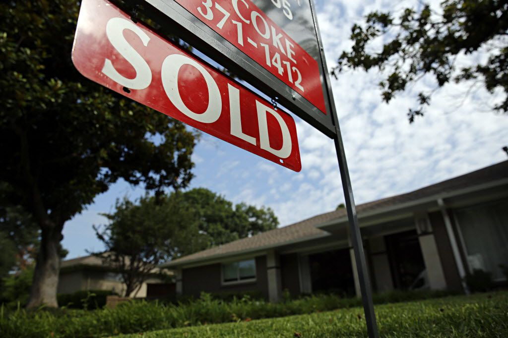A sold sign in front of a home on Stonetrail Drive in northern Dallas. (G.J. McCarthy/The Dallas Morning News)