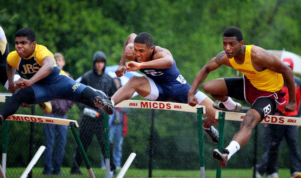 Saturday May 15, 2010--Ezekiel Elliott, from John Burroughs, left, Spencer Dudley, from St. Charles, center, Martin Hill, from Lutheran North, right, take off at the start of the finals of the boys 110 meter hurdles during Class 3 district track meet at MICDS on Saturday. (David Carson/St. Louis Post-Dispatch)