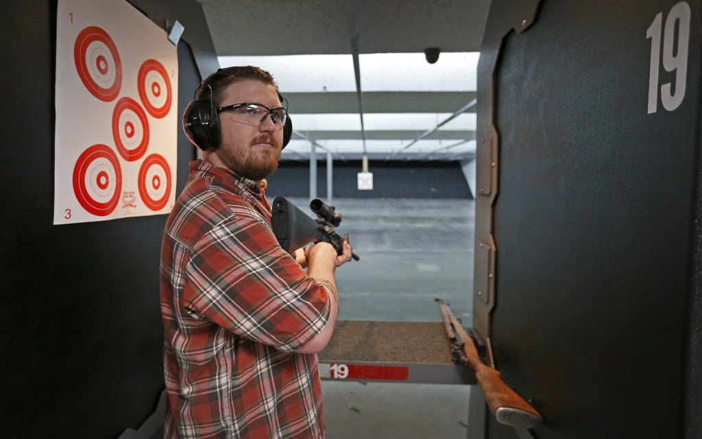 Ben Allen poses for a photograph with his AR-15 rifle manufactured by Runner Runner Guns at Eagle Gun Range in Lewisville, Texas, Monday, June 27, 2016. (Jae S. Lee/The Dallas Morning News)