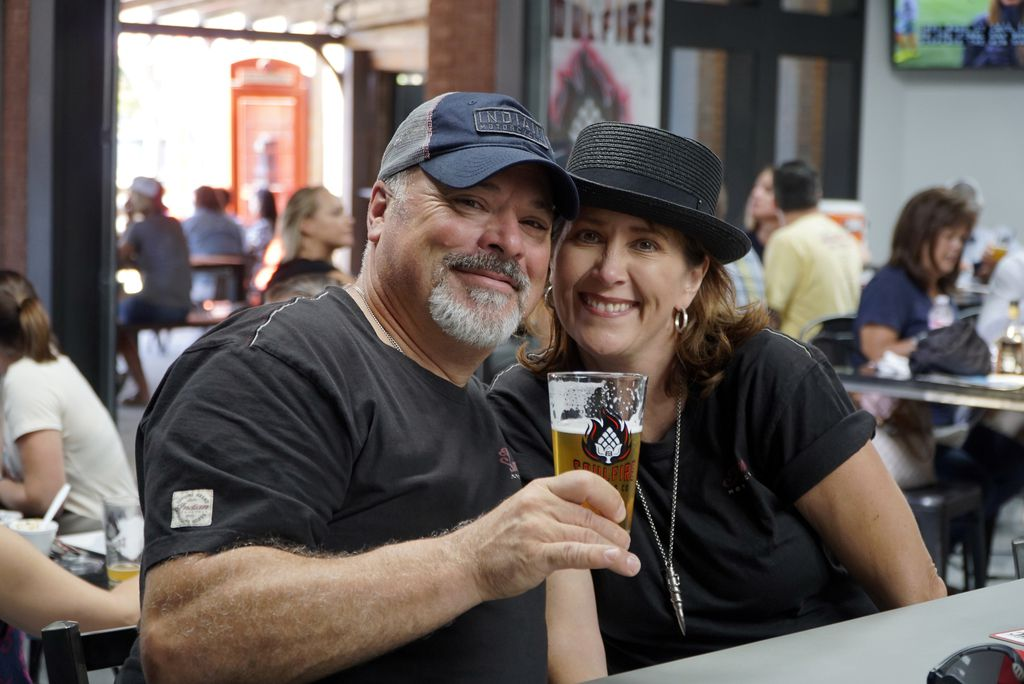 John Brusch and Gina Yates enjoy a cold beverage at Soul Fire Brewing Co.'s grand opening party.