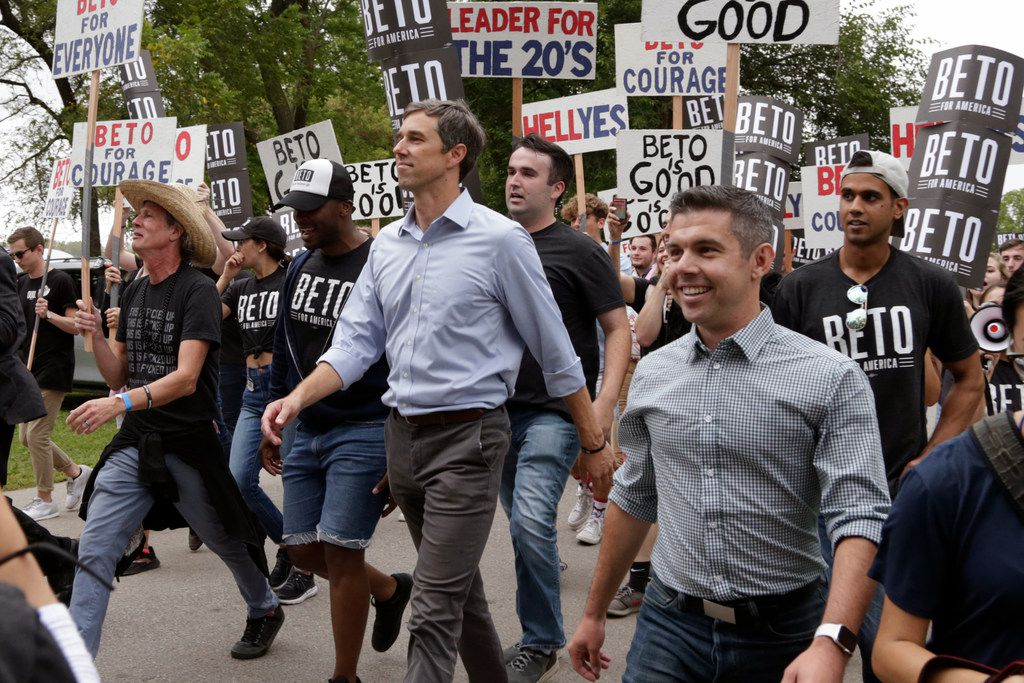 Democratic presidential candidate former Texas Rep. Beto O'Rourke marches with supporters at the Polk County Democrats Steak Fry, in Des Moines, Iowa, on Sept. 21, 2019. (AP Photo/Nati Harnik)