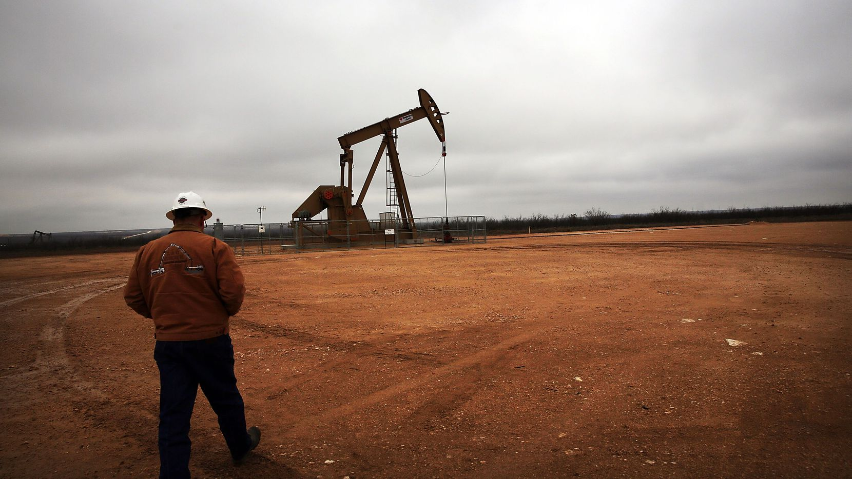 Exxon Mobil has bought leases for about 250,000 acres in the Permian Basin and plans to ramp up investment and production in shale gas plays.  (Spencer Platt/Getty Images)