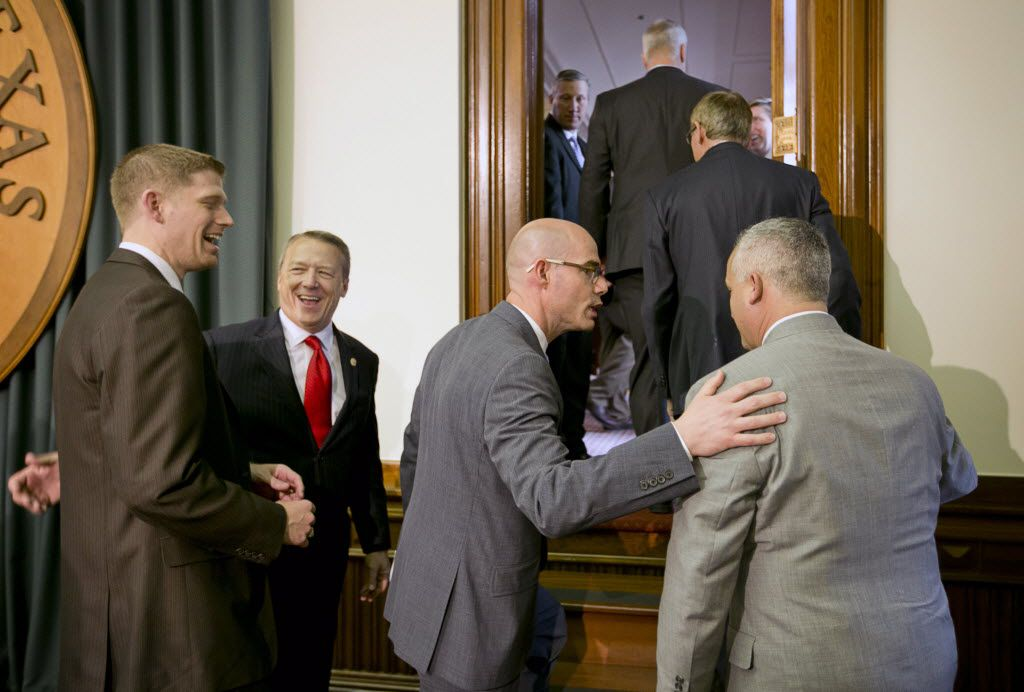 From left to right: Texas state Reps. Matt Krause, Ron Simmons, Dennis Bonnen and Dwayne Bohac confer. (2015 File Photo/Austin American-Statesman)