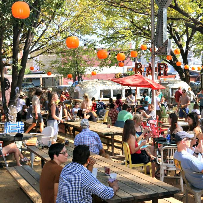 The beer garden at the Truck Yard offers plenty of mismatched lawn furniture to make you feel right at home.