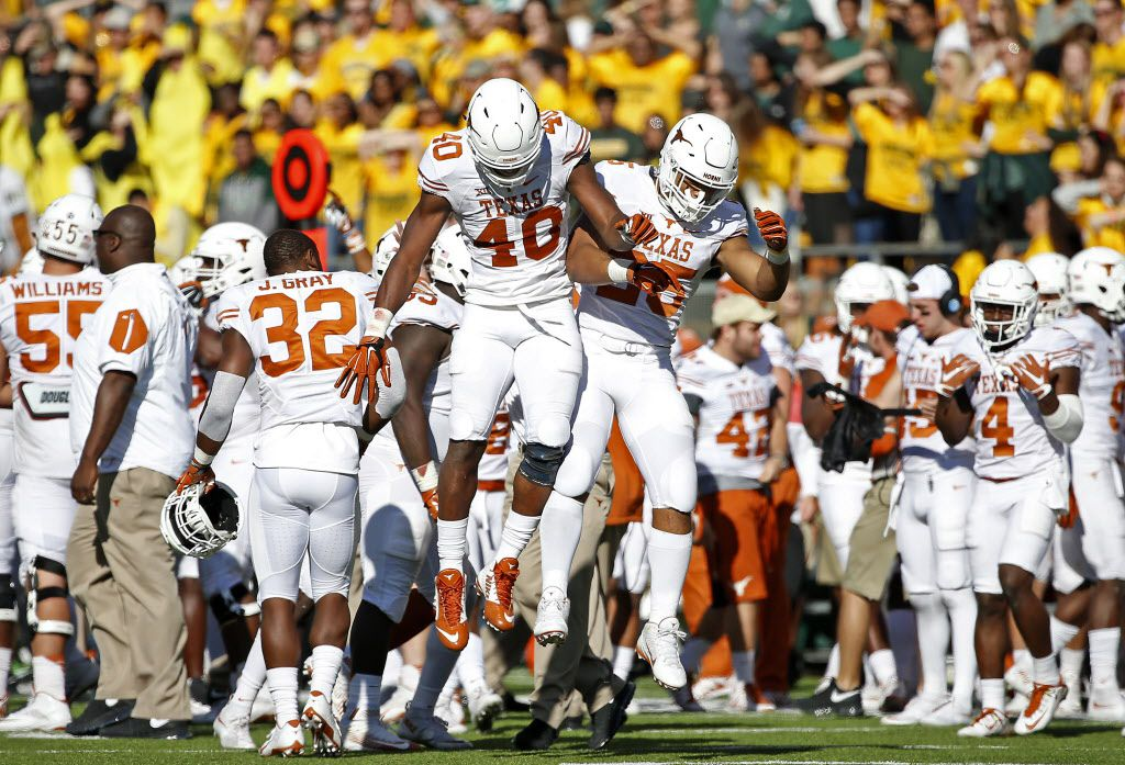 Texas defensive end Naashon Hughes (40) and cornerback Antwuan Davis (25) celebrate in the last minutes of the end of the second half after the Longhorns recovered a Baylor fumble at McLane Stadium on Saturday, Dec. 5, 2015, in Waco, Texas. Texas won 23-17. (Jae S. Lee/The Dallas Morning News)