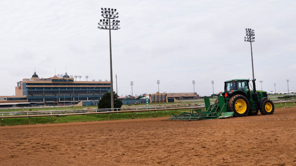 A Lone Star Park employee prepares the horse track to get ready for the opening of thoroughbred racing season, which begins April 20 at the park in Grand Prairie.