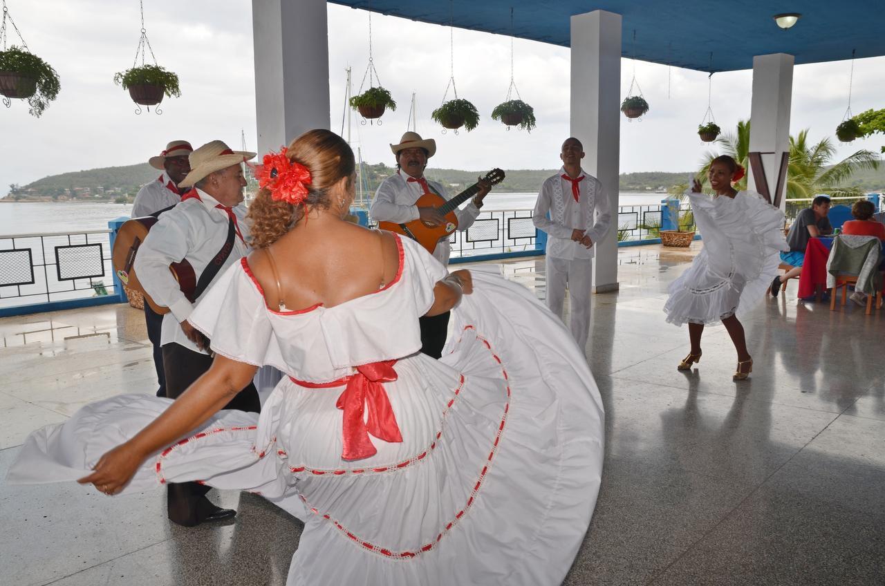 Left:  Adonia passengers enjoyed lunch and a dance performance at Punta  Gorda restaurant in  Santiago de Cuba.
