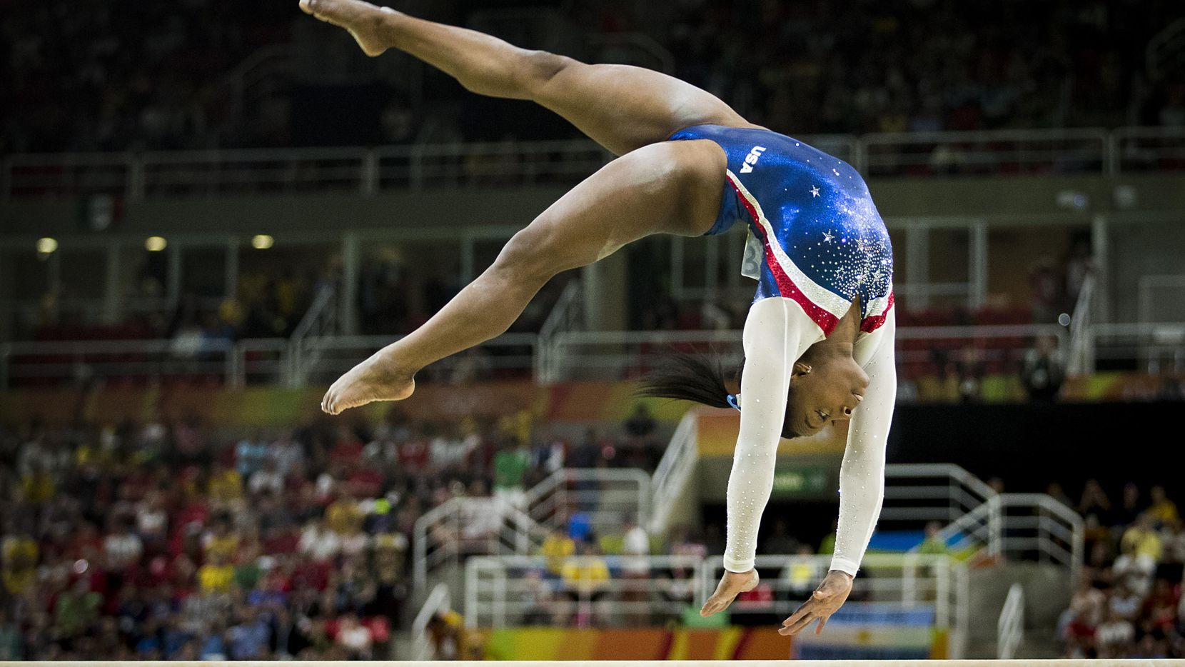Simone Biles of the United States competes on the balance beam during the women's gymnastics all around final at the Rio 2016 Olympic Games on Thursday, Aug. 11, 2016, in Rio de Janeiro.