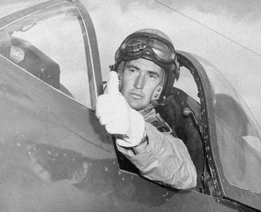 Ted Williams flashes the pilot's traditional thumb-up sign of  OK  to his mechanic while taking his attack aviation refresher training in a Corsair Fighter plane at Cherry Point, N.C., on Sept. 4, 1952.