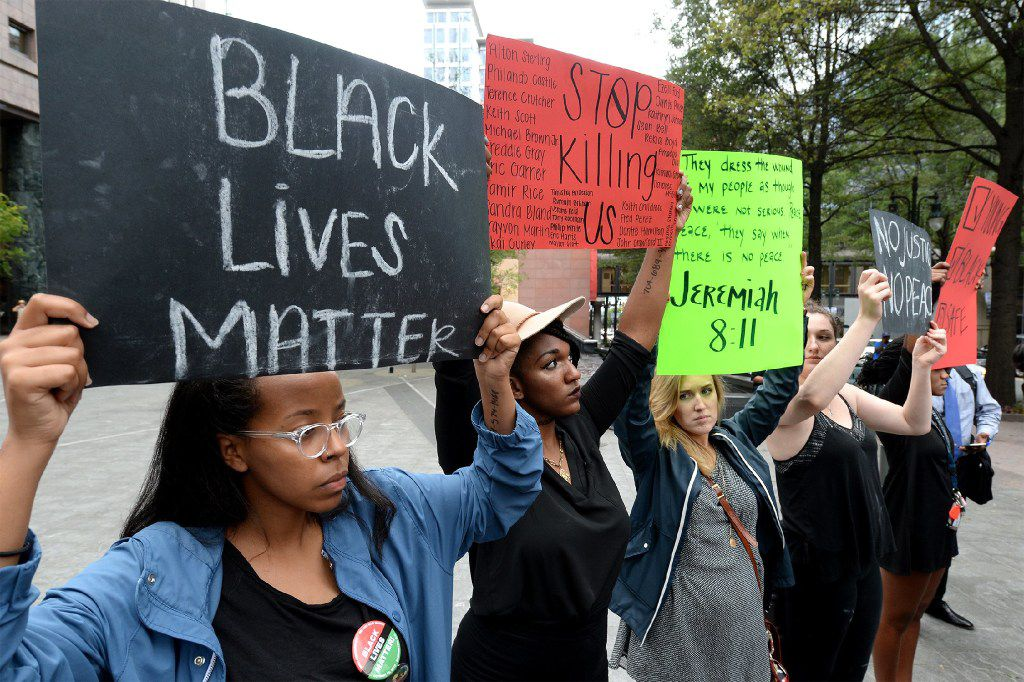 College students in Charlotte, N.C., protest the deadly police shooting in their city.