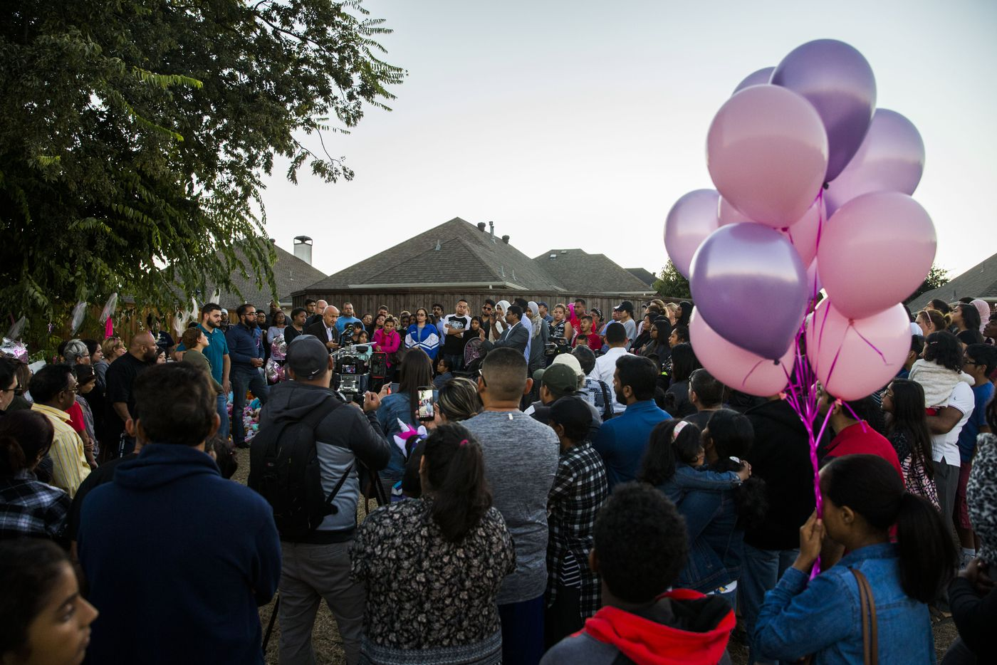 People gather at a memorial for missing 3-year-old Sherin Mathews on Sunday.