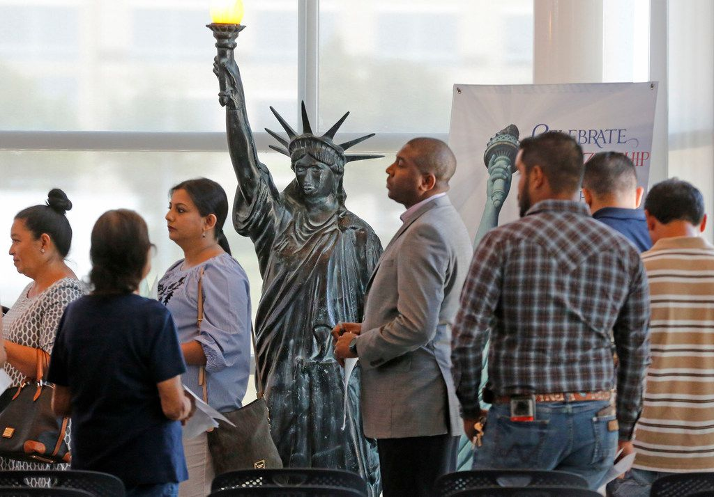 Immigrants, such as these at a citizenship ceremony last year in Irving, are a big part of Texas' growth story. A new business coalition is pushing against anti-immigrant sentiment in Austin and Washington.  (Louis DeLuca/The Dallas Morning News)