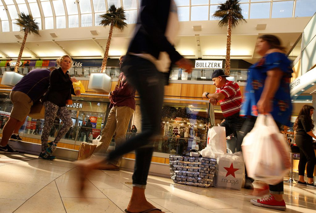 People wait with their packages at Galleria Dallas in Dallas on Nov. 23, 2018. (Nathan Hunsinger/The Dallas Morning News)
