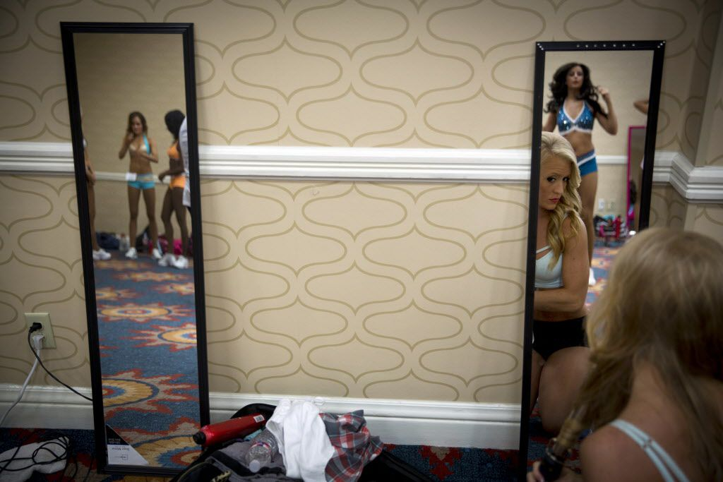 Participants ready themselves for final auditions to join the 2015-2016 Dallas Mavericks Dancers team Sunday, July 12, 2015 in Dallas. More than 40 women made it to the finals, vying for a spot to take part in a training camp later in the week.
