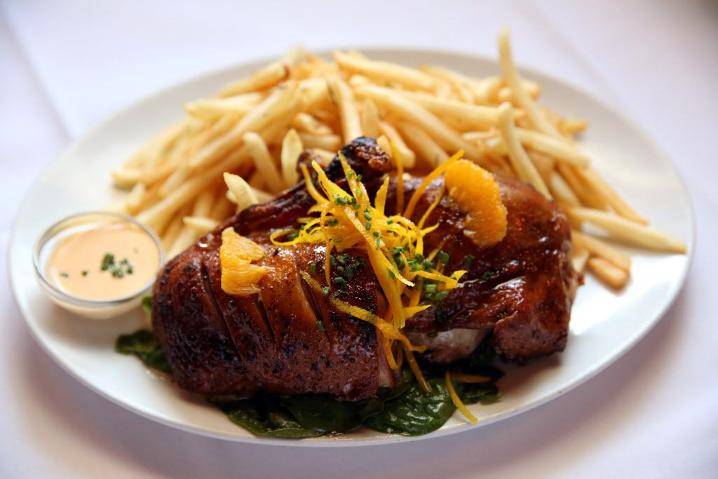 Honey-glazed roasted duck with frites has been on the menu since 1985.