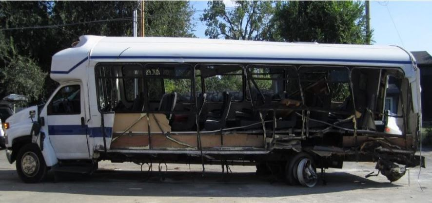 The 2008 Champion Defender bus is shown as it looked after the crash.