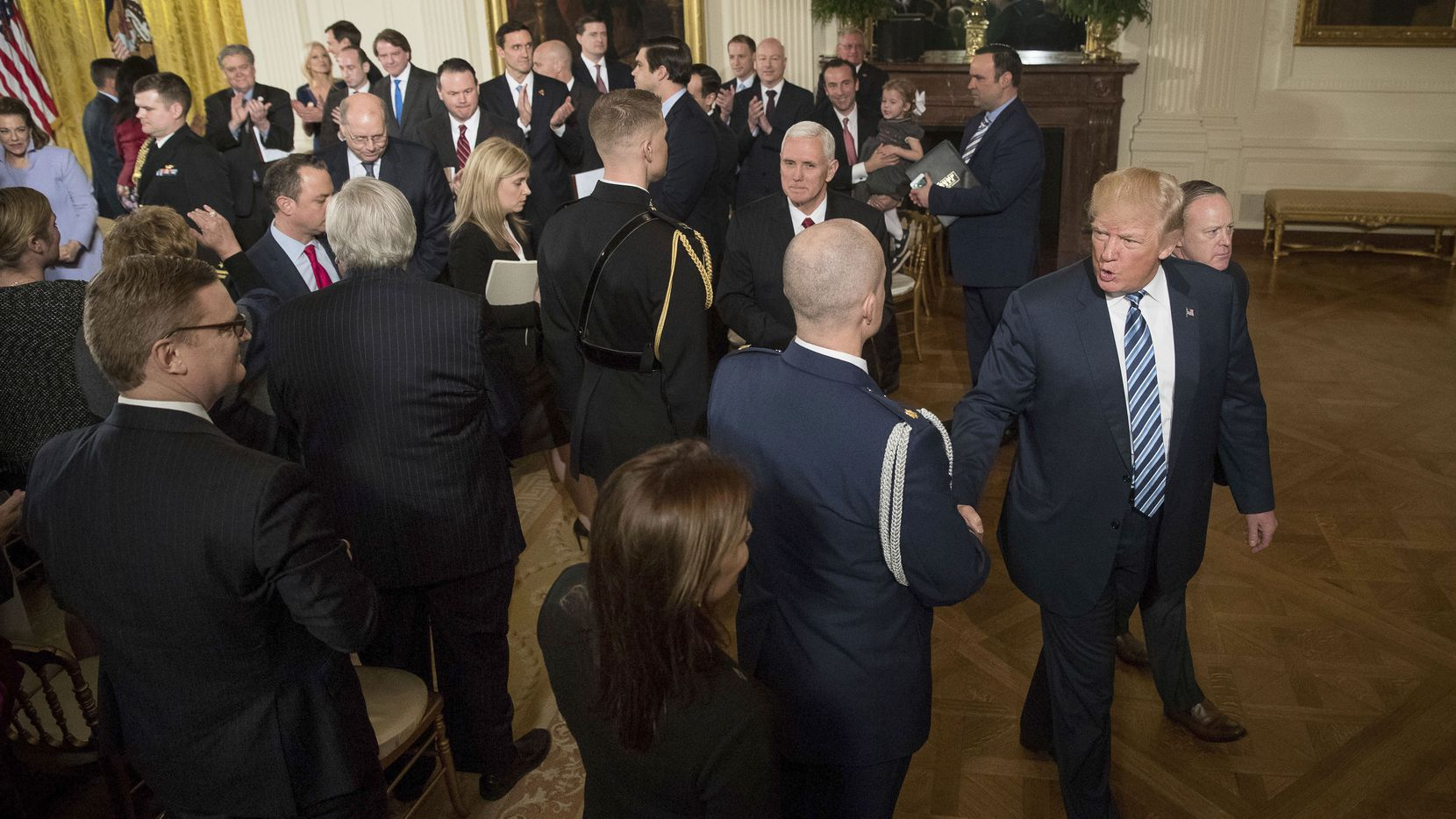 President Donald Trump departs following a White House senior staff swearing in ceremony in the East Room of the White House, Sunday, Jan. 22, 2017, in Washington.