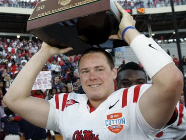 Mississippi quarterback Jevan Snead (4) holds the Field Scovell Trophy after beating Texas Tech 47-34 in the Cotton Bowl NCAA college football game, Friday, Jan. 2, 2009, in Dallas. (AP Photo/Tony Gutierrez) DNB132_ 01032009xaldia  12072009xSPORTS