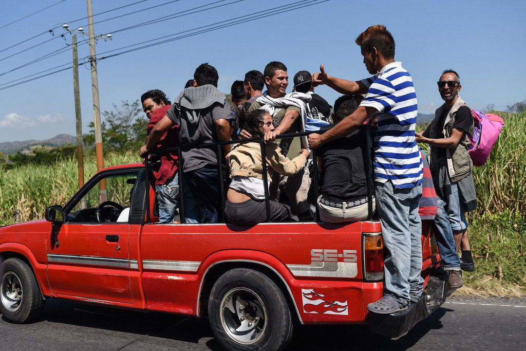 Honduran migrants heading to the United States with a second caravan travel aboard a pick-up just over 30 miles south of Guatemala City, on Jan. 17, 2019.