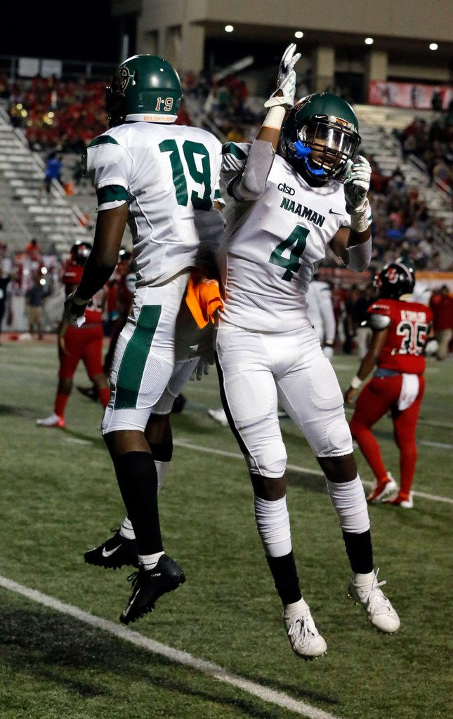 Naaman Forest WR Bryson Huey (19) and QB Clayton Thompson (4) celebrate after Huey's touchdown catch during the first half of their high school football game at Williams Stadium in Garland on Friday, October 4, 2019. (John F. Rhodes / Special Contributor)