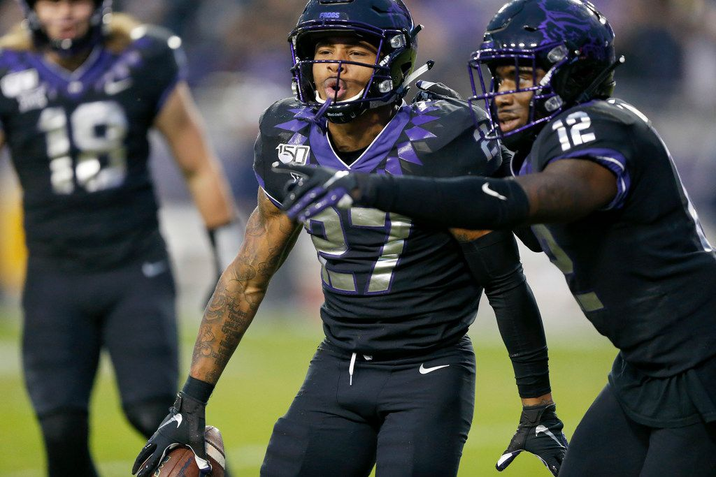 TCU Horned Frogs safety Ar'Darius Washington (27) celebrates his interception of West Virginia Mountaineers wide receiver Sam James in the second quarter at Amon G. Carter Stadium in Fort Worth, Friday, November 29, 2019. (Tom Fox/The Dallas Morning News)