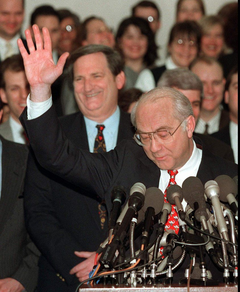 Sen. Phil Gramm, R-Texas, acknowledges applause on Capitol Hill on Feb. 14, 1996 after announcing that he is dropping out of the race for the Republican presidential nomination. Gramm, once considered Bob Dole's top challenger, dropped out of the race, a victim of a weak fifth place finish in the Iowa caucuses. Sen. Bob Smith, R-N.H. looks on at left.