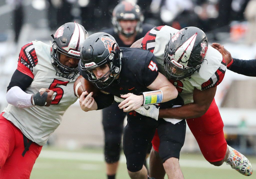 Mansfield Legacy defensive back Jalen Catalon (5) strips the ball from Aledo quarterback Jake Bishop (4) resulting in a fumble recovery for Legacy in the second quarter during the Class 5A Division II state semifinal between Aledo and Mansfield Legacy at Pennington Field in Bedford, Texas Saturday December 16, 2017. (Andy Jacobsohn/The Dallas Morning News)