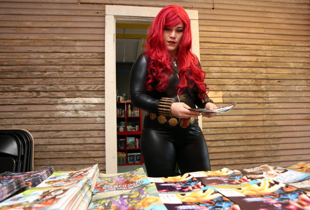 Geline Spinks, dressed as Marvel comic's Black Widow, selects comics at annual Free Comic Book Day event at Red Pegasus Games and Comics in Dallas, Texas, last year.