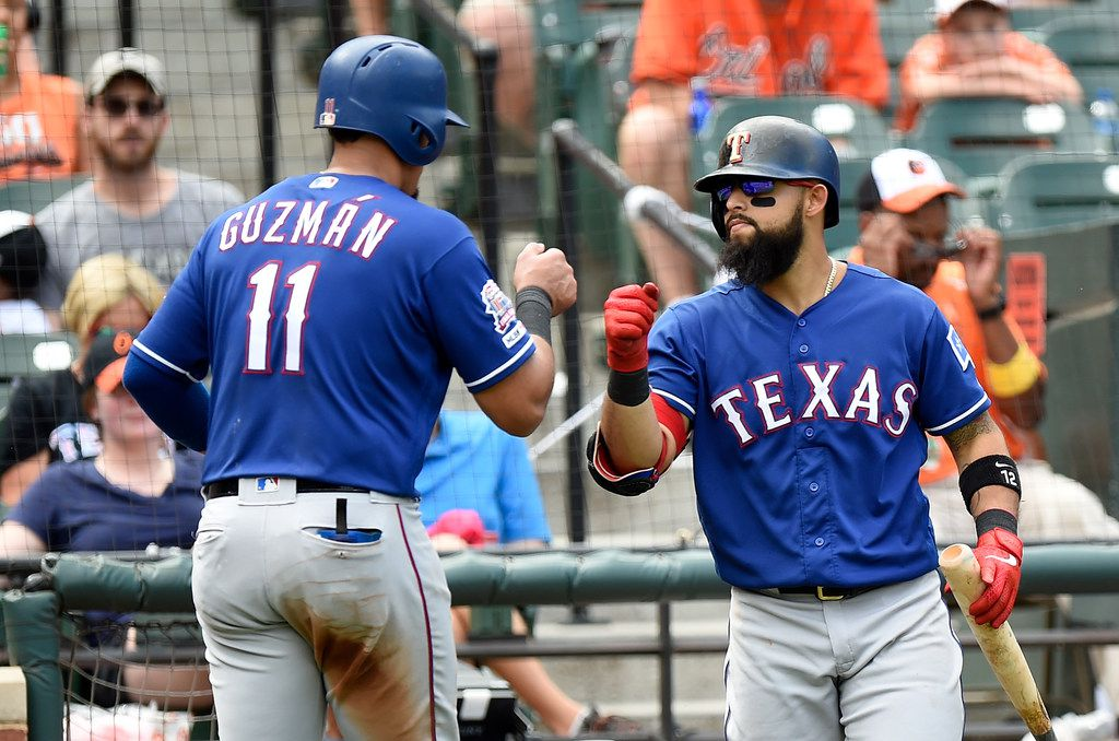 BALTIMORE, MD - SEPTEMBER 08:  Ronald Guzman #11 of the Texas Rangers celebrates with Rougned Odor #12 after scoring in the sixth inning against the Baltimore Orioles at Oriole Park at Camden Yards on September 8, 2019 in Baltimore, Maryland.