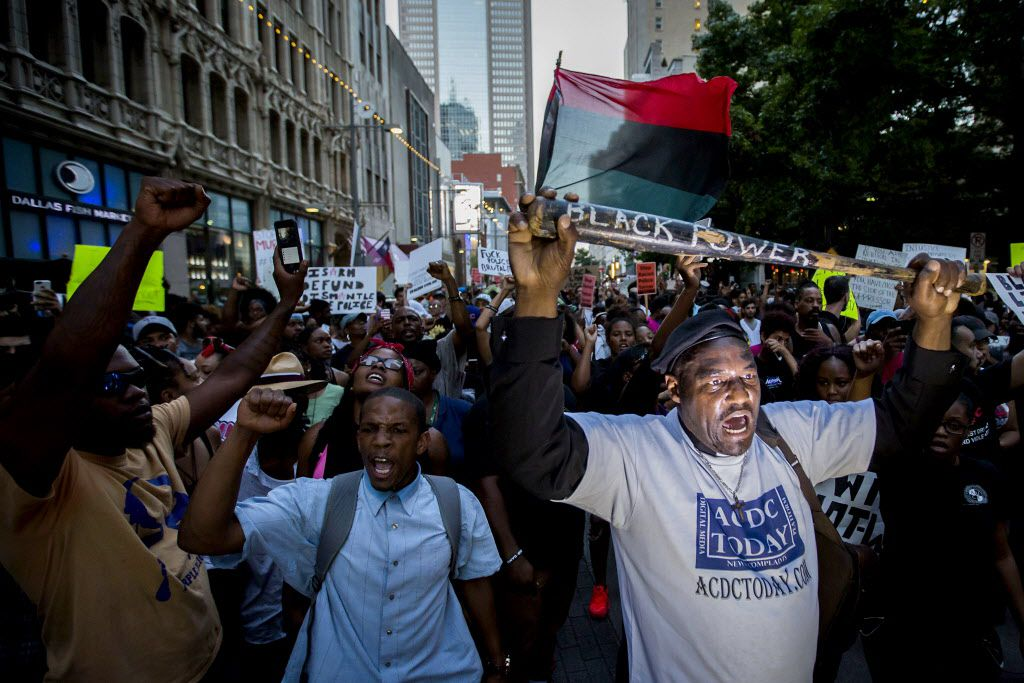 Ernest Walker leads other protestors at a rally in downtown Dallas on Thursday, July 7, 2016. Dallas protestors rallied in the aftermath of the killing of Alton Sterling by police officers in Baton Rouge, Louisiana and Philando Castile, who was killed by police less than 48 hours in Minnesota. (Smiley N. Pool/The Dallas Morning News)