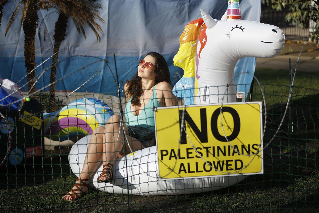 """Rights group Amnesty stage a demonstration outside the UK headquarters of US travel company Tripadvisor on January 30, 2019. Digital tourism giants Airbnb, Booking.com, Expedia and TripAdvisor are profiting from """"war crimes"""" by offering services in Israeli settlements, rights group Amnesty International said in a report published today."""